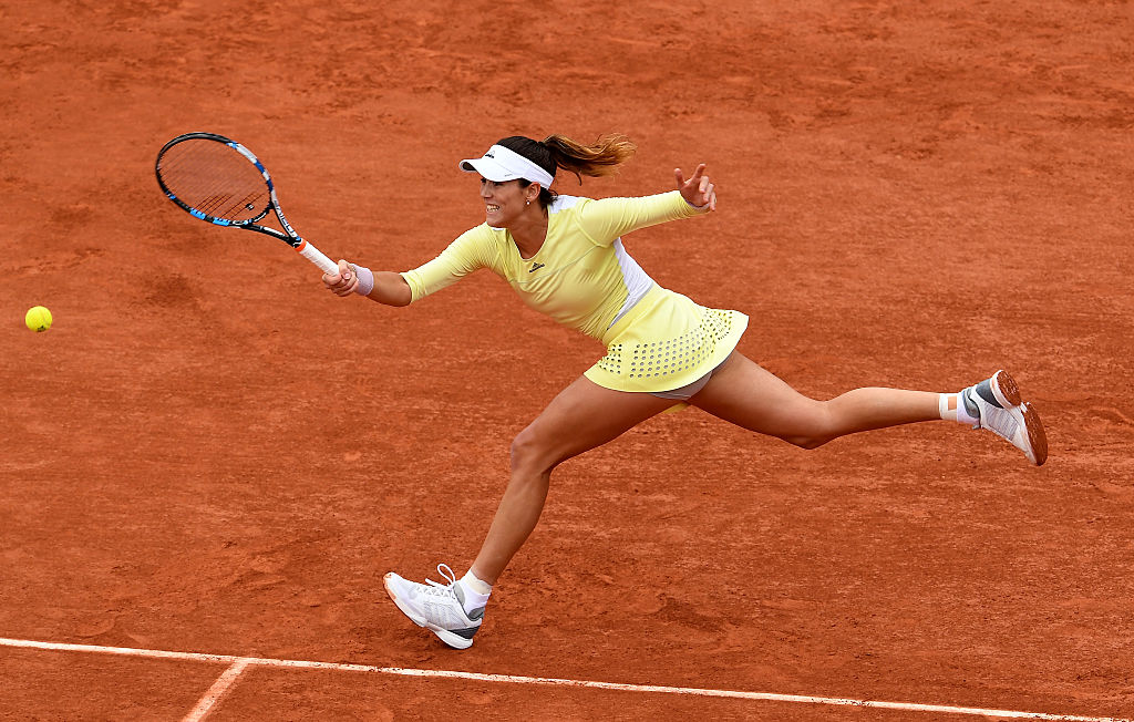 PARIS, FRANCE - JUNE 04: Garbine Muguruza of Spain hits a forehand during the Ladies Singles final match against Serena Williams of the United States on day fourteen of the 2016 French Open at Roland Garros on June 4, 2016 in Paris, France. (Photo by Dennis Grombkowski/Getty Images)